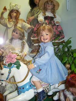 Doll riding on carasoul horse